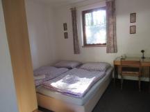 Dvoulůžkový pokoj v penzionu